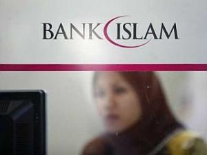 An employee of Bank Islam works at a branch in Putrajaya outside Kuala Lumpur