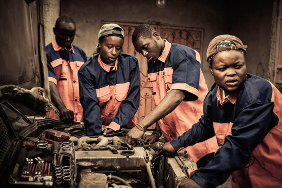 african women in pink and navy in garage