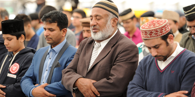 Ahmadiyya Muslims gather for Friday prayers in the main tent as they join up to 30,000 Muslims to pledge allegiance to the Caliph during Jalsa Salana UK 2014 in Alton, Hampshire.