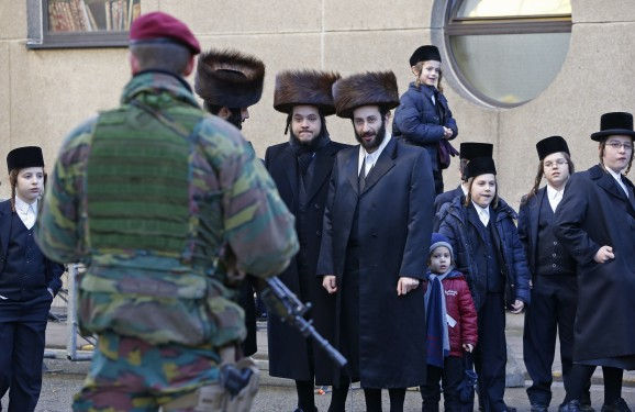 A Belgian paratrooper guards outside a Jewish school in the central city of Antwerp